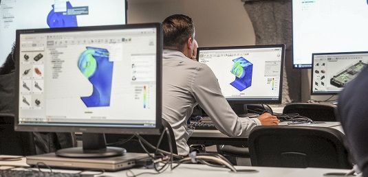 Classroom training at Autodesk University London 2018. Autodesk Fusion software is on the monitors.